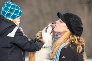 Ája, giving kisses to her breeder Alena